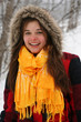 girl with yellow scarf in the snow