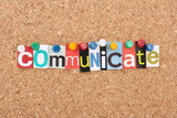 The word Communicate in magazine letters on a notice board poster