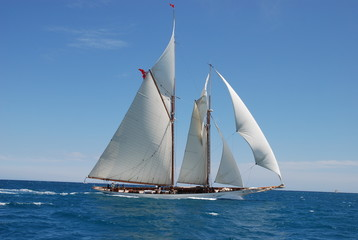 classic yacht under full sail