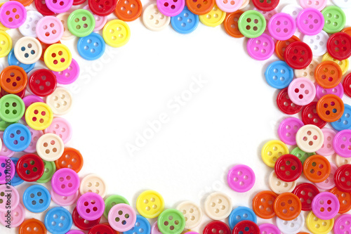 Multi color buttons on white background with copy space