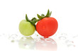 Green And Red Cherry Tomatoes on Water Drops