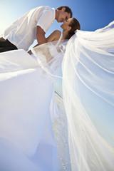 Bride & Groom Married Couple Kissing at Beach Wedding
