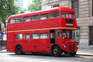 Empty red double-decker on street in London, England.