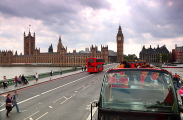 Travel red double-decker buses on Westminster bridge in London