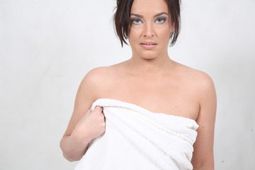 A young woman wrapped in a bath towel