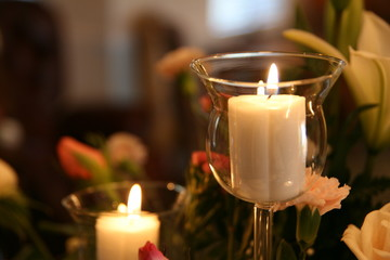 candle flame in wedding arrangement in a home