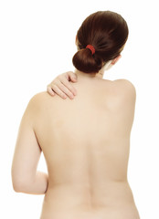 Woman massaging pain back isolated over a white background