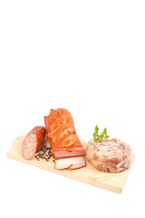 Salami, bacon, aspic, parsley on wooden board