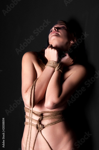 Bondage women  on black background