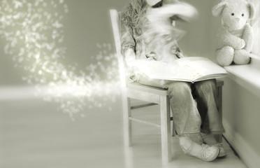 Girl reading magical book