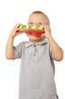 Little boy eating watermelon with drops of juice on shirt
