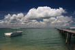Boat floats calmly on tropical island ocean pier