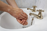 Man washing hand under running water