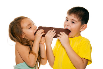Girl and boy eating chocolate