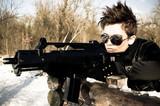 Girl aiming a machine gun - 28397203