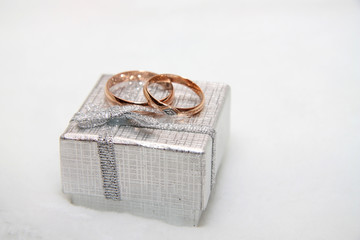 Wedding rings on a small box.