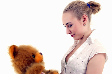 Young woman with teddy bear