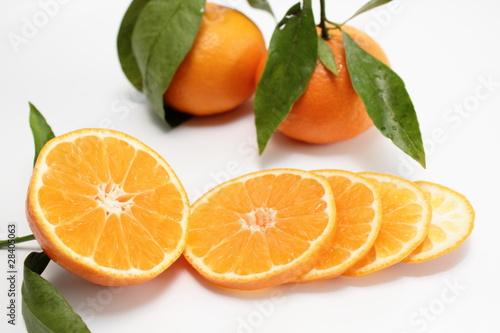 Fotobehang Plakjes fruit clementine in scheiben