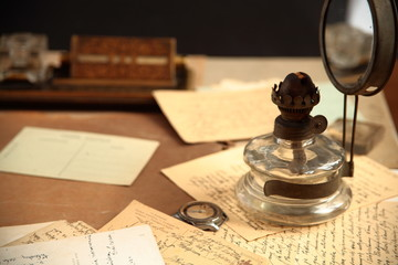 Old correspondence and oil-lamp