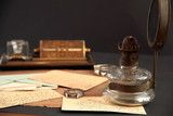 Old correspondence and oil-lamp poster