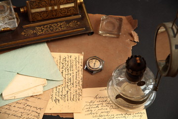 Old correspondence, ink-pot and oil-lamp