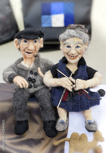 Grandpa and knitting Grandma wool puppets