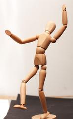 Wood manequin dancing