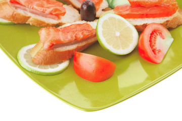 fresh salmon sandwiches and vegetables