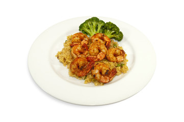 Fried shrimps with rice and broccoli on side