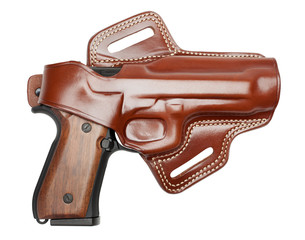 handgun in a leather holster isolated on white