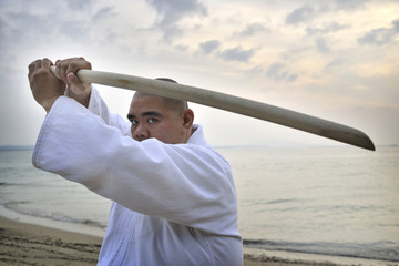 Aikido man with bokken