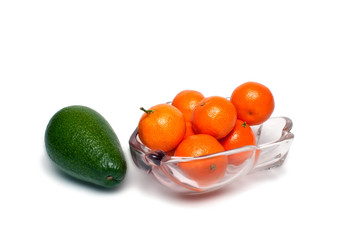 bowl with avocado and mandarins on a white background