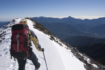 mountain climber with beautiful snow scenery.