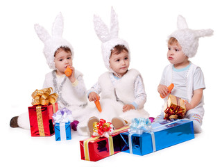 three new year rabbit boy with gifts
