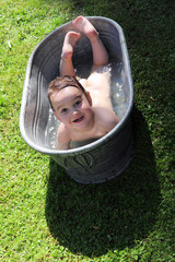 joy caucasian child bathing outdoors in bath