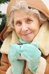 happy granny drinking hot tea