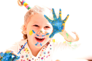 girl with paint hands isolated on white