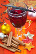 Glass of mulled wine with vanilla, cinnamon.