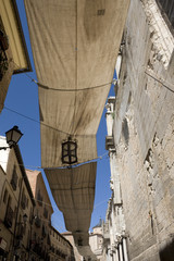 Street awnings in Toledo - Protection during  procession