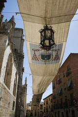 Awning and lantern over the Cathedral street - Toledo