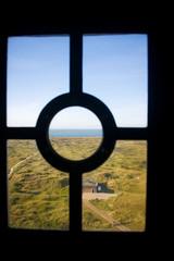Coast through lighthouse window