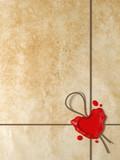Sigillo di ceralacca a forma di cuore su carta antica