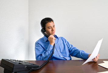 young Businessman on Phone Call