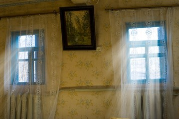 rays of sun pushing through a room window