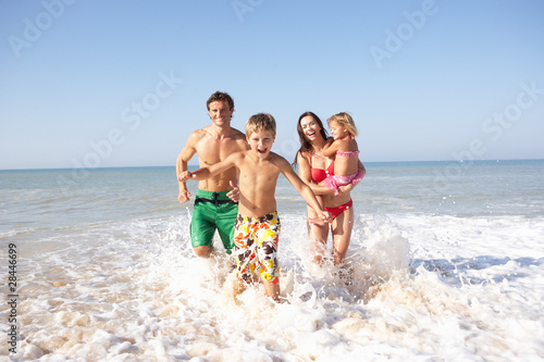 canvas print picture Young family play on beach