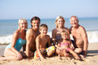 Three generation family pose on beach