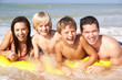 Young family pose on beach