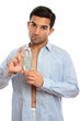 Handsome man showing perfume cologne fragrance