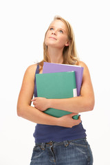 Studio Portrait Of Female Student Holding Folders