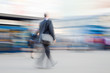 Motion blurred image of businessman rushing to office